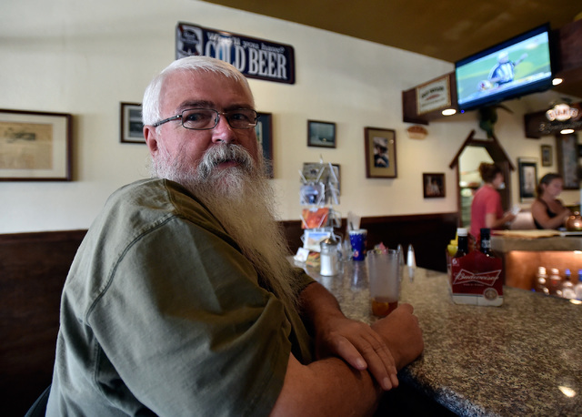 Resident Steve Miller relaxes inside Bruno's Country Club,Tuesday, Aug. 23, 2016, in Gerlach, Nev. The residents of the small northern Nevada town have mixed feelings about the annual countercultu ...