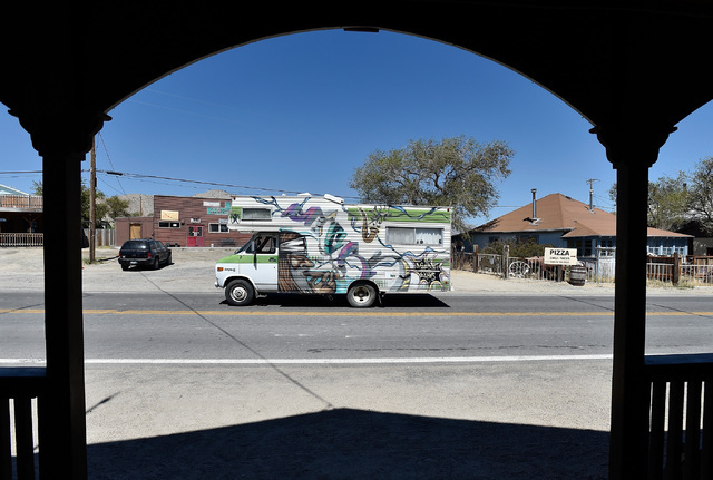 """A camper belonging to a long-time """"burner"""" is seen passing through Gerlach, Nev., Tuesday, Aug. 23, 2016. The residents of the small northern Nevada town have mixed feelings abou ..."""