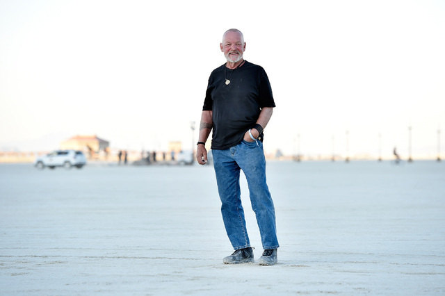 Burning Man Project chairman and founding board member Will Peterson stands on the playa as the Burning Man festival takes shape at the Black Rock Desert, Tuesday, Aug. 23, 2016. Peterson has been ...