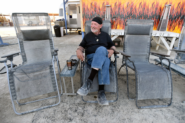 Burning Man Project chairman and founding board member Will Peterson relaxes as the Burning Man festival takes shape at the Black Rock Desert, Tuesday, Aug. 23, 2016. Peterson has been part of the ...