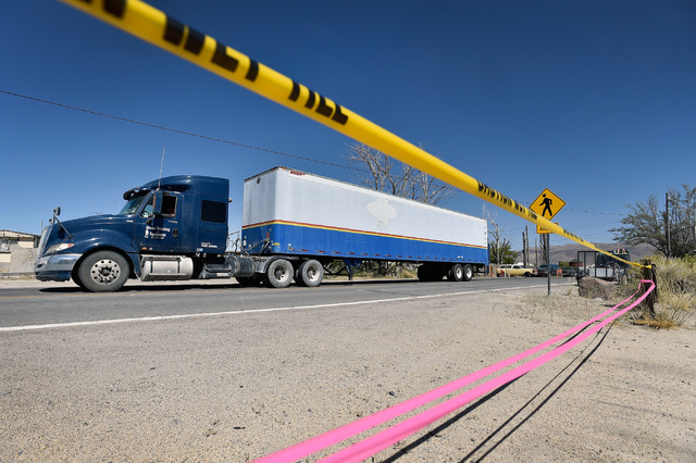 Ribbons block access to a driveway as a semi-trailer truck travels along highway 447 as it passes through Gerlach, Nev., Tuesday, Aug. 23, 2016. Seventy thousand people and thousands of vehicles a ...