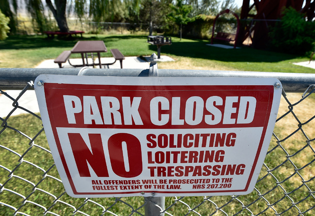 A sign is seen posted at a small park in Gerlach, Nev., Tuesday, Aug. 23, 2016. The town has begun closing its local park along the highway 447 after years of dealing with nuisance issues during t ...