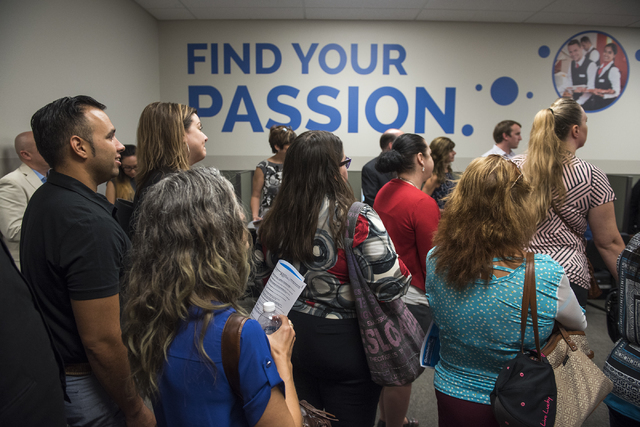 Jason Ali, left, takes part in a tour during Goodwill of Southern Nevada's grand opening of its Career Connections center at the Boulevard Mall in Las Vegas on Thursday, Aug. 4, 2016. Ali, who is  ...