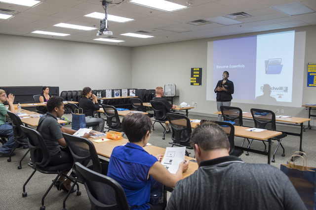 Workshop fFacilitator Stephanie Cochran, top right, teaches a resume esstentials class to attendees during Goodwill of Southern Nevada's grand opening of its newest Career Connections center at th ...