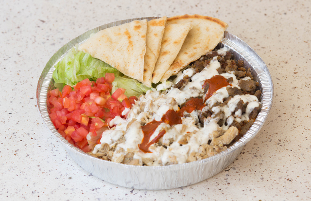 A Combination Platter Served By The Halal Guys Courtesy