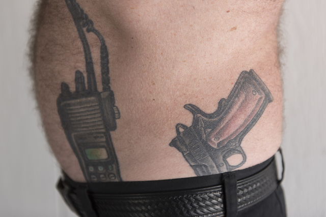 Retired Capitol Police Officer And Nevada Highway Patrol Trooper Brad Carson Shows His Tattoos Of A Police Radio And A Guncrafter Industries 50 Caliber Handgun At His Las Vegas Home Monday Aug