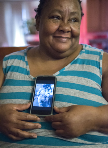 Janice Bullocks glances at her granddaughter, Chaveze, 2, at her Las Vegas residence on Sunday, July 31, 2016, while showing a photo of herself and Chaveze, in the hospital as she recovers from a  ...