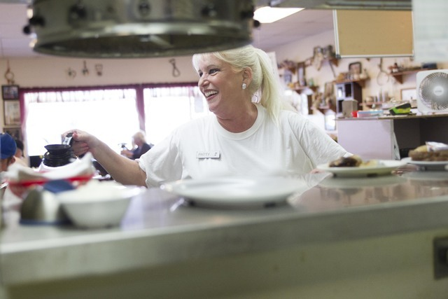 Long-time Lou's Diner waitress Patricia Misuraca, 58, tops off a cup a coffee for a guest as she works the breakfast shift at Lou's Diner in Las Vegas on Wednesday, August 03, 2016. (Richard B ...