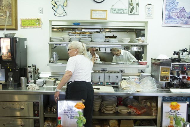 Long-time Lou's Diner waitress Patricia Misuraca, 58, works kitchen line as she works the breakfast shift at Lou's Diner in Las Vegas on Wednesday, August 03, 2016. (Richard Brian/Las Vegas Re ...
