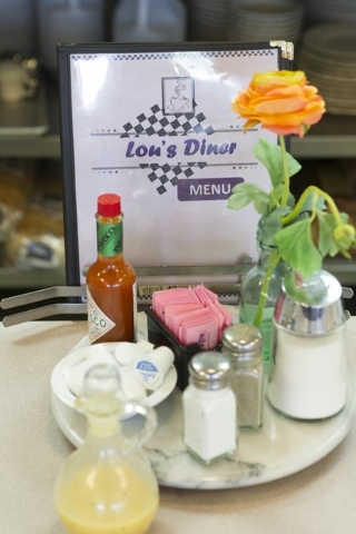 A menu and a various condiments are seen on the counter at Lou's Diner in Las Vegas on Wednesday, August 03, 2016. (Richard Brian/Las Vegas Review-Journal) Follow @vegasphotograph