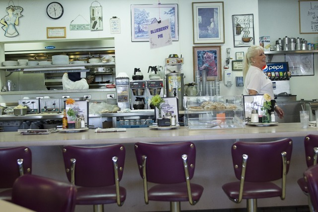 Long-time Lou's Diner waitress Patricia Misuraca, 58, walks behind the counter as she works the breakfast shift at Lou's Diner in Las Vegas on Wednesday, August 03, 2016. (Richard Brian/Las Ve ...