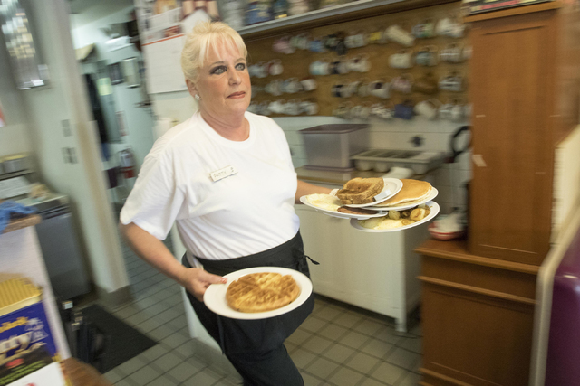Long-time Lou's Diner waitress Patricia Misuraca, 58, walks an order to guest as she works the breakfast shift at Lou's Diner in Las Vegas on Wednesday, August 03, 2016. (Richard Brian/Las Veg ...