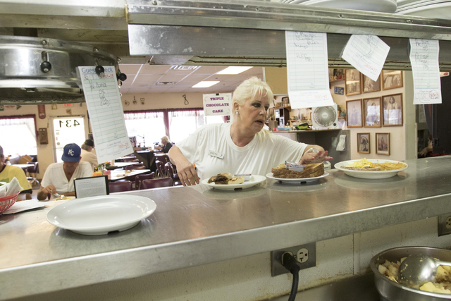 Long-time Lou's Diner waitress Patricia Misuraca, 58, picks up an order from kitchen line as she works the breakfast shift at Lou's Diner in Las Vegas on Wednesday, August 03, 2016. (Richard B ...