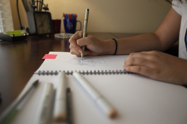 Amanda Galvan works on a drawing at her home on Sunday, Aug. 21, 2016, in Las Vegas. (Rachel Aston/Las Vegas Review-Journal Follow @rookie__rae)