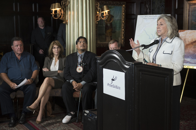 U.S. Rep. Dina Titus, D-Nev., right, speaks during a news conference at the Mandalay Bay hotel-casino in Las Vegas on Thursday, Aug. 18, 2016, to release the second Gold Butte damage report.  (Mar ...