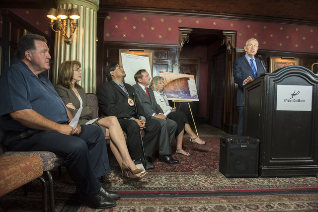 Sen. Harry Reid, right, speaks during a news conference at the Mandalay Bay hotel-casino in Las Vegas on Thursday, Aug. 18, 2016, to release the second Gold Butte damage report.  (Martin S. Fuente ...