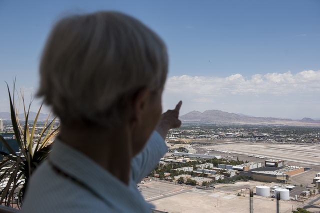 Las Vegas resident Ursula WIlson-Booth points towards the location of Gold Butte during a news conference at the Mandalay Bay hotel-casino in Las Vegas on Thursday, Aug. 18, 2016, to release the s ...