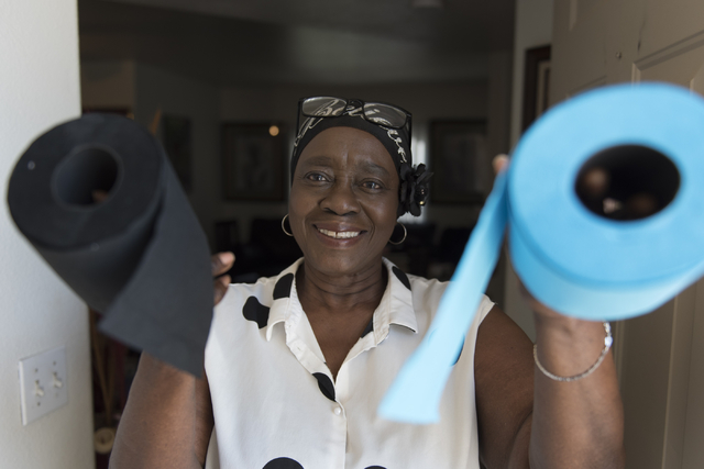 Joyce Eatman holds rolls of colored toilet paper Aug. 2 that her group sells as a fundraiser. Jason Ogulnik/View