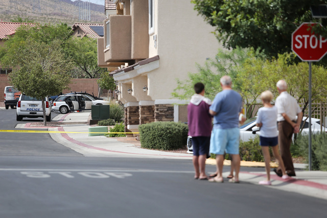 Residents gather to watch police investigate a homicide in which police say a man was shot to death by his roommate in Henderson, on Saturday, Aug. 27, 2016. Brett Le Blanc/Las Vegas Review-Journa ...