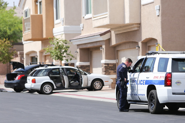 Police officers talk at the scene of a homicide in which police say a man was shot to death by his roommate in Henderson, on Saturday, Aug. 27, 2016. Brett Le Blanc/Las Vegas Review-Journal Follow ...
