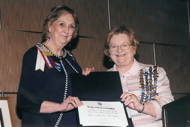 From left, Margaret Hendrickson, regent, OST chapter of the National Society Daughters of the American Revolution, accepts the third place award for the Nevada State Society on behalf of Dr. Linda ...