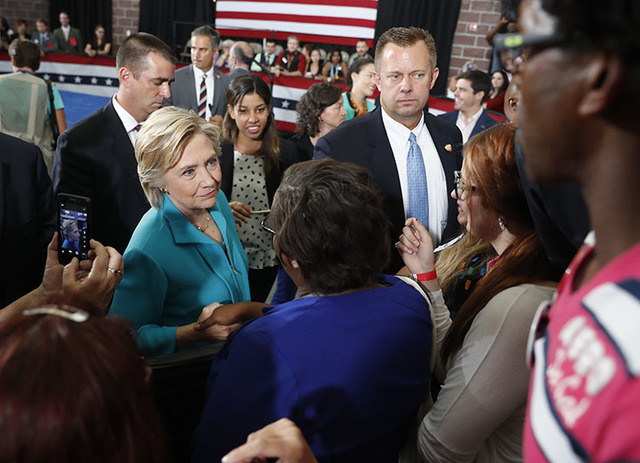 FHillary Clinton greets people in the audience after speaking at a campaign event at Truckee Meadows Community College, in Reno on Aug. 25. (Carolyn Kaster/The Associated Press)