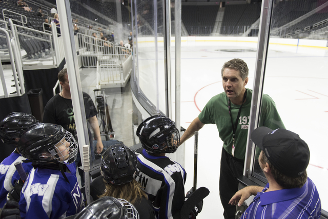 Former NHL player Murray Craven, second from right, greets members of the Storm Youth Hockey organization as they wait to skate on the newly installed ice at T-Mobile Arena in Las Vegas Wednesday, ...