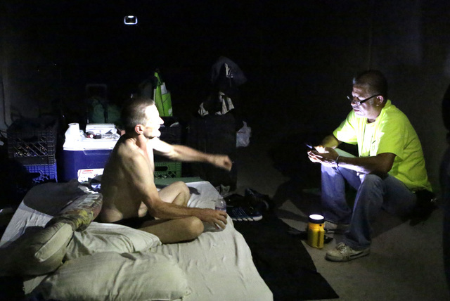 HELP of Southern Nevada's Lou Lacey, right, speaks to Kregg Nettorur on Thursday, July 28, 2016. Nettorur lives in a tunnel near Welcome to Las Vegas sign under Las Vegas Boulevard. Bizuayehu Tesf ...