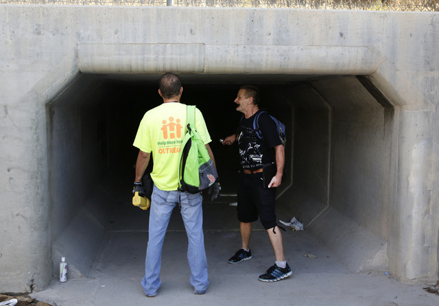 HELP of Southern Nevada's Lou Lacey, left, speaks to Kregg Nettorur on Thursday, July 28, 2016. Nettrour lives in a tunnel near Welcome to Las Vegas sign under Las Vegas Boulevard. Bizuayehu Tesfa ...