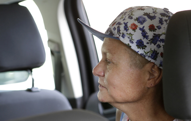 Dawn Louden, homeless Marine veteran, sits in the car as she is transported by the VA homeless vets outreach team to VA Community Resource and Referral Center for evaluation on Thursday, July 28,  ...