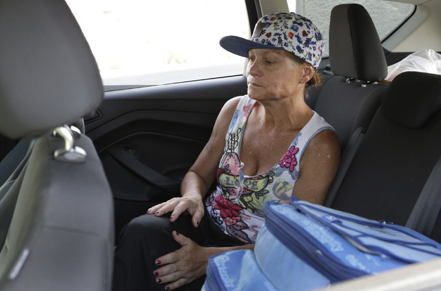 Dawn Louden, homeless Marine veteran, sits in the car as she is transported by the VAճ homeless vets outreach team to VA Community Resource and Referral Center for evaluation on Thursday, July 28 ...