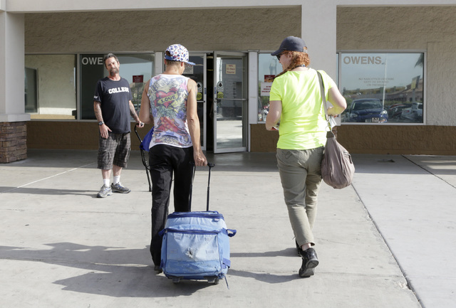 Dawn Louden, homeless Marine veteran, left, and Tammi Ewing, clinical social worker at the VA, arrive at VA Community Resource and Referral Center on Thursday, July 28, 2016. Bizuayehu Tesfaye/Las ...