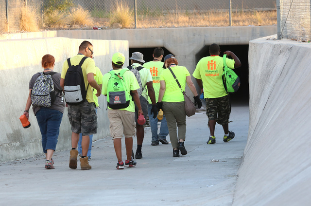 HELP of Southern Nevada and the VA's homeless vets outreach team converge on a tunnel near the Welcome to Las Vegas sign where homeless people sleep under Las Vegas Boulevard on Thursday, July 28, ...
