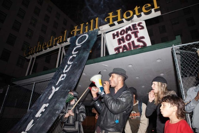 Self-proclaimed activists take over a building as part of a public demonstration for Homes Not Jails, a group that advocates using vacant and abandoned housing for the homeless in San Francisco in ...