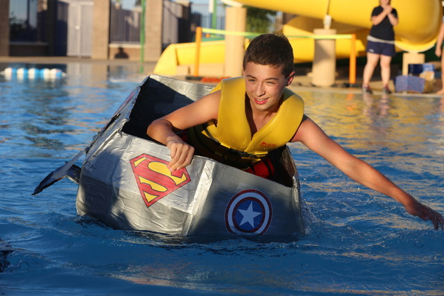 Junior lifeguard Nate Schmitt, 13, races across the pool during Desert Breeze Aquatic Facility's annual Cardboard Boat Regatta July 22. Special to View