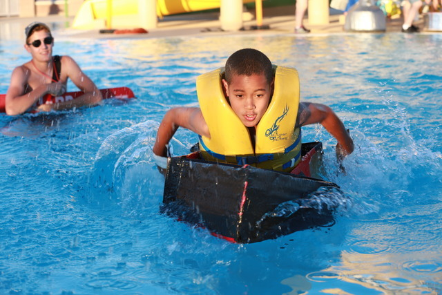 Jameson McMillan zoomed across the Desert Breeze Aquatic Facility to earn the fastest ship prize during the Cardboard Boat Regatta July 22. Special to View