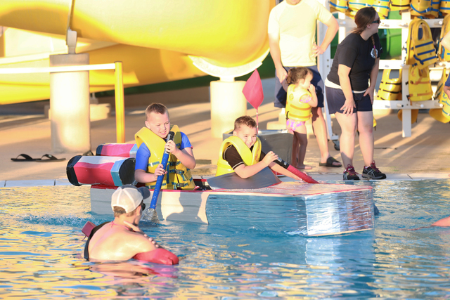 """Brayden Renville, 10, left, and his brother Connor, 4, won most creative for their """"Star Wars""""-inspired land speeder during the Cardboard Boat Regatta at Desert Breeze Aquatic Facility July 22. Sp ..."""