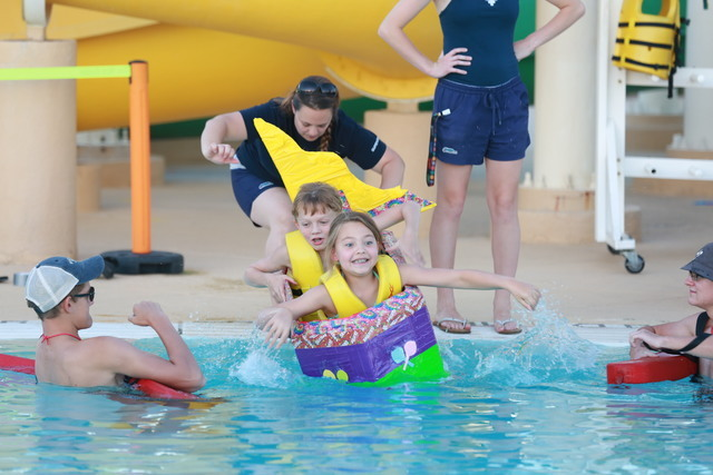 Alexa Gould, 9, and her brother Austin Gould, 8, and their ship the Candy Sail met a watery end early on during the Cardboard Boat Regatta at Desert Breeze Aquatic Facilty July 22. Special to View