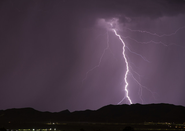 Lightning during thunderstorms in Henderson Monday night, Aug. 22, 2016. (Submitted by John McFie through AtTheScene)