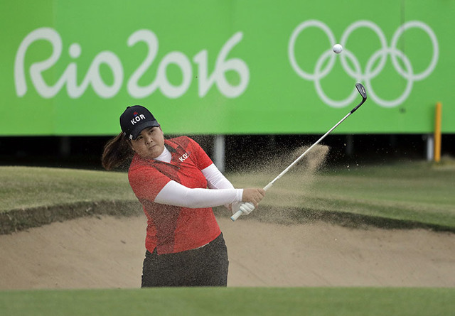 Inbee Park of South Korea hits from the bunker on the 18th hole during the final round of the women's golf event at the 2016 Summer Olympics in Rio de Janeiro, Brazil, Saturday, Aug. 20, 2016. Par ...