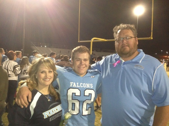JD Reynolds, center, is shown with his parents Kelli and Jerry during a high school football game at Foothill High in Henderson. JD Reynolds is one of several local players hoping to play for Adam ...
