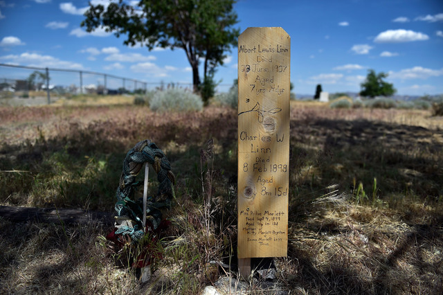 """A recently replaced  grave marker for children is seen in a historic cemetery Tuesday, June 7, 2016, in Reno. """"It's for the kids,"""" Joesph Galara said, wanting to save the cemetery from developers. ..."""
