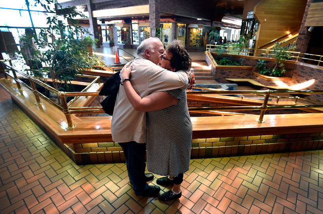 """Joseph Galata, left, receives a hug from Evonne Kezios as they meet before his weekly """"Spotlight Youth"""" radio show Tuesday, June 7, 2016, in Reno. The drama teacher referred to Galata as an """"elf o ..."""