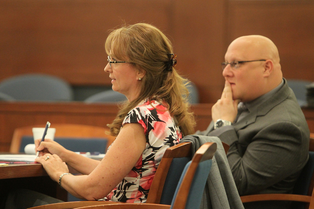 Judge Catherine Ramsey and attorney Steven Goldstein listen to Judge Eric Johnson at the Regional Justice Center on Thursday, July 2, 2015, in Las Vegas. A hearing was held regarding the validity  ...