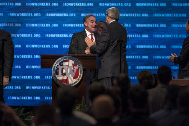 Democratic vice presidential nominee Tim Kaine is greeted by Walter Wise, general president emeritus, during the Iron Workers International 43rd Convention at The Mirage hotel-casino in Las Vegas  ...