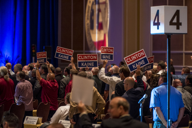Supporters hold up signs during the Iron Workers International 43rd Convention at The Mirage hotel-casino in Las Vegas on Monday, Aug. 22, 2016. Joshua Dahl/Las Vegas Review-Journal