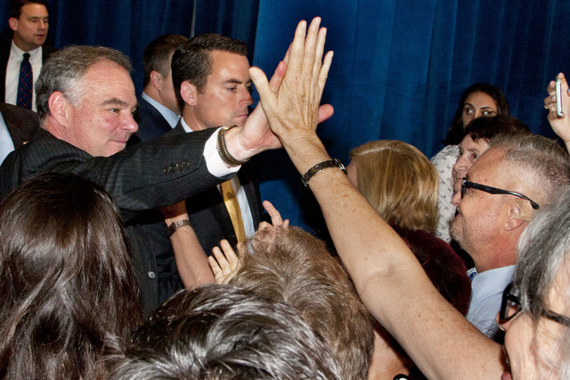 Democratic vice presidential candidate Sen. Tim Kaine, D-Va., gives a high-five to an attendee during a rally at the Local 525 Plumbers & Pipefitters Training Center at 750 Legion Way in Las V ...