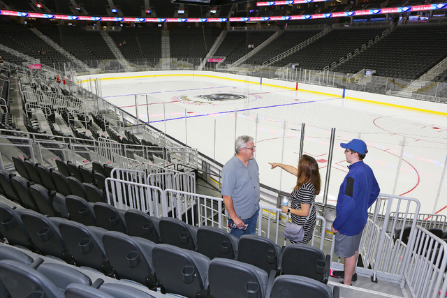 Mark Berry, from left, and wife Mika and son Brian look at seat options during an open house for prospective 2017 Vegas NHL hockey season ticket holders at T-Mobile Arena Monday, Aug. 1, 2016, in  ...