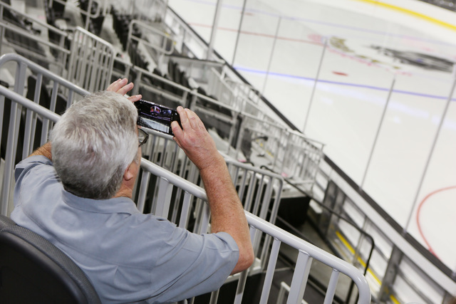 Joe Hulbert takes a photo of center ice during an open house for prospective 2017 Vegas NHL hockey season ticket holders at T-Mobile Arena Monday, Aug. 1, 2016, in Las Vegas. (Ronda Churchill/Las  ...