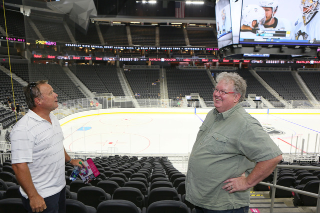 Michael Feeney, left, and Daniel Pray explore seating options during an open house for prospective 2017 Vegas NHL hockey season ticket holders at T-Mobile Arena Monday, Aug. 1, 2016, in Las Vegas. ...